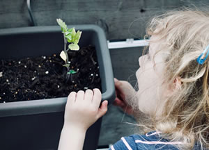 Girl learning about plants